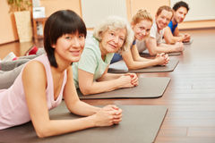 Group in yoga class with senior citizen Royalty Free Stock Image