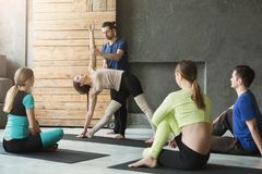 Group with yoga instructor in fitness club Stock Photos