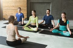 Group with yoga instructor in fitness club Stock Image
