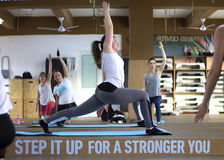 Group yoga. Ladies doing yoga with their personal yoga trainer Stock Photography