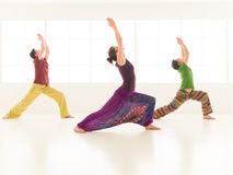 Group yoga virabhadrasana Royalty Free Stock Images