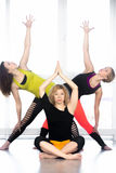 Group of yogi females practicing yoga in class Stock Photos