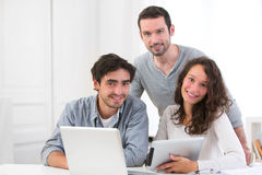 Group of young active people working together Royalty Free Stock Photos