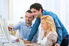 Group of young active people working together Stock Image