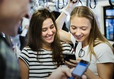 Group of young adult friends using smartphones in the subway stock photos