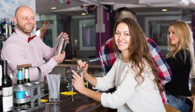 Group of young adults in bar Stock Photo