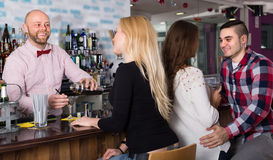 Group of young adults in bar Royalty Free Stock Images
