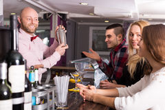 Group of young adults in bar Stock Image