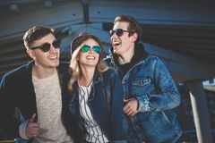 Group of young adults having fun spending the day in the city royalty free stock photos