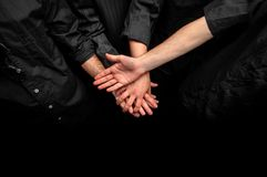 Group of young adults making a pile of hands Royalty Free Stock Photo