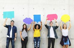 Group of young adults outdoors holding empty placard copyspace t. Hought bubbles Stock Photos
