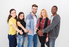 Group of young adults standing royalty free stock image