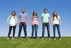 Group of Young Adults or Teenagers. A multi-racial group of young adults or teenagers looking at the camera in a serious manner Royalty Free Stock Image