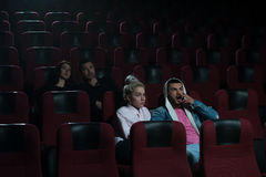 Group of young adults watching movie in theater Royalty Free Stock Photo