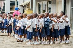 Group of young African pre school children dancing and singing in school courtyard, Matadi, Congo, Central Africa Royalty Free Stock Photography