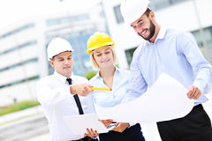 Group of young architects on site Royalty Free Stock Photo