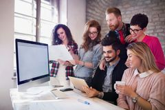 Group of young architects using digital tablet. In office Royalty Free Stock Images