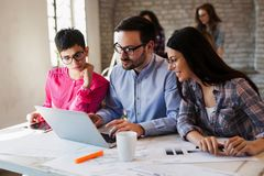 Group of young architects working on computer Royalty Free Stock Photos