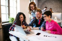 Group of young architects working on laptop Royalty Free Stock Images