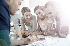 Group of young architects working on a project Royalty Free Stock Image