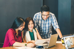 Group of young Asian business colleagues or college students in team casual discussion, startup project business meeting. Or happy teamwork brainstorm concept stock images
