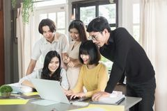 Group of young asian students high school working report together in the library Stock Photography
