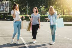 Group of young Asian Woman shopping in an outdoor market with shopping bags in their hands. Young women show what they got in shopping bag under warm sunlight Stock Images