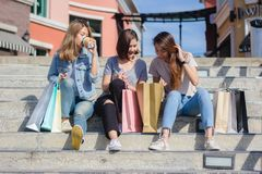 Group of young Asian Woman shopping in an outdoor market with shopping bags in their hands. Group of young Asian women shopping in an outdoor market with Stock Photography