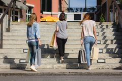 Group of young Asian woman shopping in an outdoor market with shopping bags in their hands. Group of young Asian women shopping in an outdoor market with Royalty Free Stock Photo