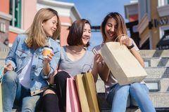 Group of young Asian woman shopping in an outdoor market with sh stock photo