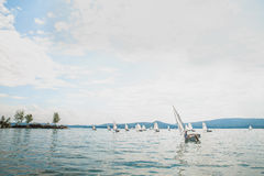 Group of young athletes on boats of Optimist class Royalty Free Stock Photo