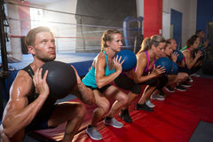 Group of young athletes exercising with balls Royalty Free Stock Image