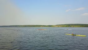 Athletes Training On Kayaks. Group of young athletes training for whitewater rafting stock footage
