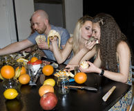 Group of young attractive people eating tropical fruits Royalty Free Stock Image