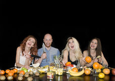 Group of young attractive people eating tropical fruits Stock Image