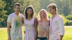 Group of young attractive people posing for camera at Holi color festival. Stock footage stock video