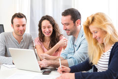 Group of 4 young attractive people working on a laptop Stock Photos