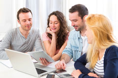 Group of 4 young attractive people working on a laptop Royalty Free Stock Images