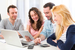 Group of 4 young attractive people working on a laptop Royalty Free Stock Photos