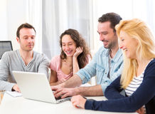 Group of 4 young attractive people working on a laptop Stock Image