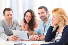 Group of 4 young attractive people working on a laptop Royalty Free Stock Image
