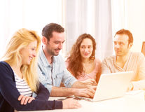 Group of 4 young attractive people working on a laptop Stock Images