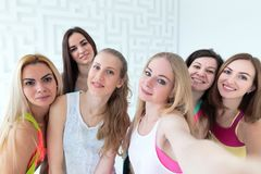 Group of young attractive women dressed in sportswear taking selfie. In a sport dance studio stock photos