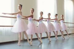 Group of young ballerinas training choreography, copy space. Young girls dancing ballet in studio. Group of young ballerinas training choreography, copy space royalty free stock images