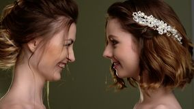 A group of young beautiful girls. Two women face close-up. stock video footage