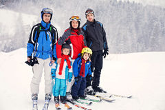 Group of young beautiful people, adults and kids, skiing Royalty Free Stock Photos