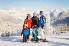 Group of young beautiful people, adults and kids, skiing Royalty Free Stock Photo