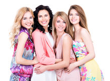 Group young beautiful smiling women. Group young beautiful smiling women in pink dresses - isolated on white royalty free stock photography