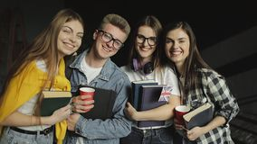 Group of Friend Standing Together Holding Books stock footage