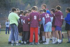 Group of young boys playing soccer Royalty Free Stock Images